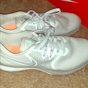 Grey Nike athletic shoes